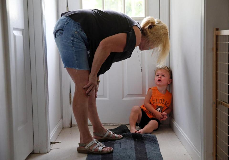 Susan Anderson Lopes explained to her 2-year-old grandson, Mason Anderson, that he cannot go outside until he eats breakfast.